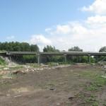 К моменту начала строительства спортцентра, моста быть уже не должно.