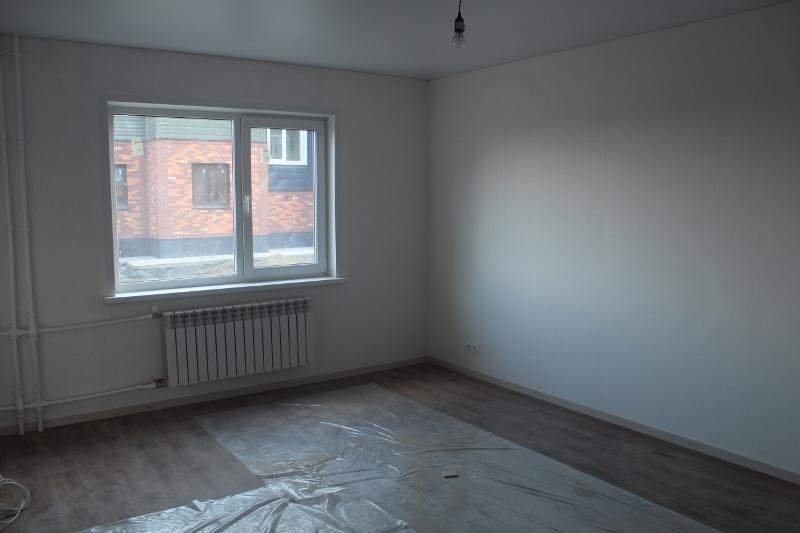 Общая комната на первом этаже, другой ракурс.