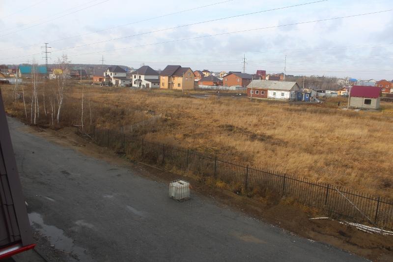 Вадима Туманова, 1а. Вид из окна мансардной квартиры в сторону частного сектора