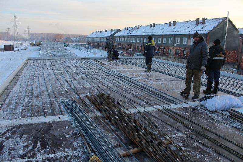 Жилой дом по ул. Вадима Туманова, 2а. Ведутся работы по устройству монолитного перекрытия первого этажа.